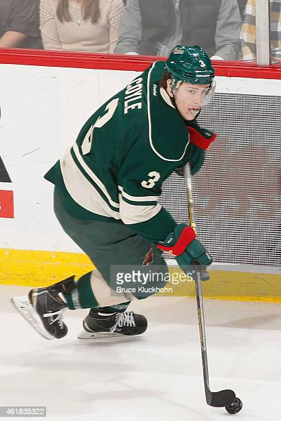 Charlie Coyle of the Minnesota Wild skates with the puck against the Arizona Coyotes during the game on January 17 2015 at the Xcel Energy Center in...