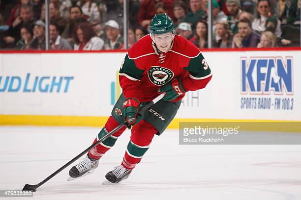 Charlie Coyle of the Minnesota Wild skates with the puck against the Edmonton Oilers during the game on March 11 2014 at the Xcel Energy Center in St...