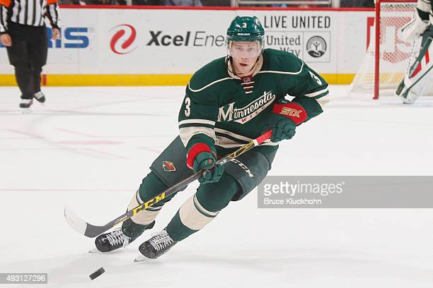 Charlie Coyle of the Minnesota Wild skates with the puck against the St Louis Blues during the game on October 10 2015 at the Xcel Energy Center in...