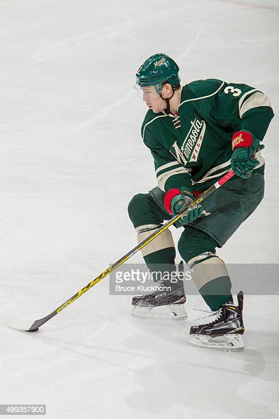Charlie Coyle of the Minnesota Wild skates with the puck against the Vancouver Canucks during the game on November 25 2015 at the Xcel Energy Center...
