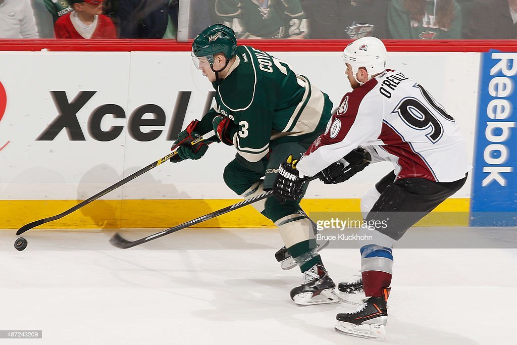 Charlie Coyle #3 of the Minnesota Wild skates with the puck pursued by Ryan O'Reilly #90 of the Colorado Avalanche during Game Six of the First Round of the 2014 Stanley Cup Playoffs on April 28, 2014 at the Xcel Energy Center in St. Paul, Minnesota.