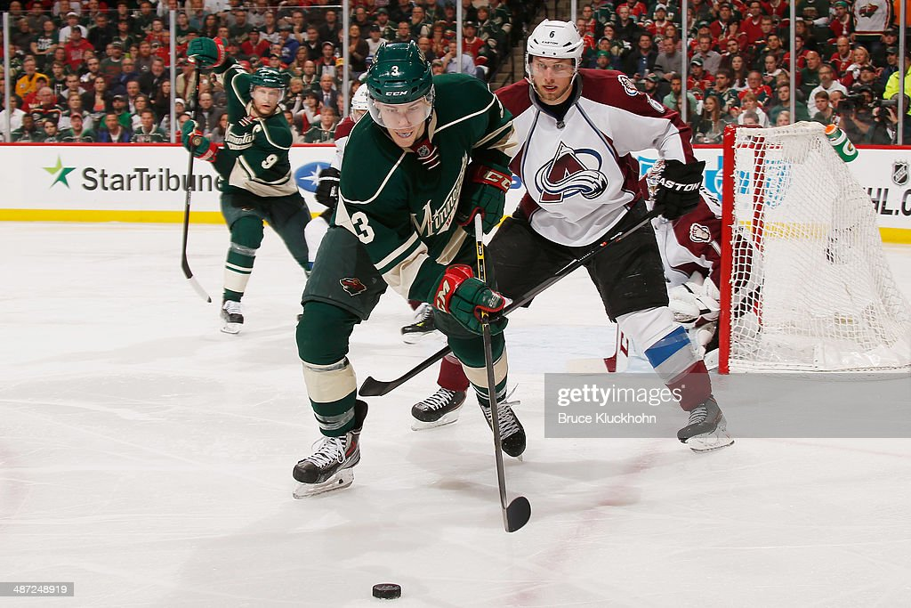 <a gi-track='captionPersonalityLinkClicked' href=/galleries/search?phrase=Charlie+Coyle&family=editorial&specificpeople=7029381 ng-click='$event.stopPropagation()'>Charlie Coyle</a> #3 of the Minnesota Wild skates with the puck while <a gi-track='captionPersonalityLinkClicked' href=/galleries/search?phrase=Erik+Johnson+-+Ice+Hockey+Player&family=editorial&specificpeople=457696 ng-click='$event.stopPropagation()'>Erik Johnson</a> #6 of the Colorado Avalanche defends during Game Six of the First Round of the 2014 Stanley Cup Playoffs on April 28, 2014 at the Xcel Energy Center in St. Paul, Minnesota.
