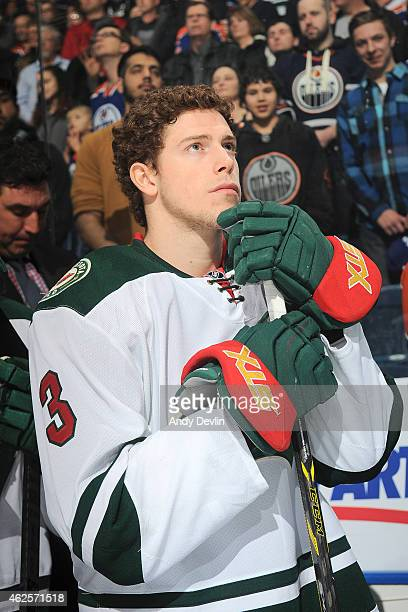 Charlie Coyle of the Minnesota Wild stands for the singing of the national anthem prior to the game against the Edmonton Oilers on January 27 2015 at...