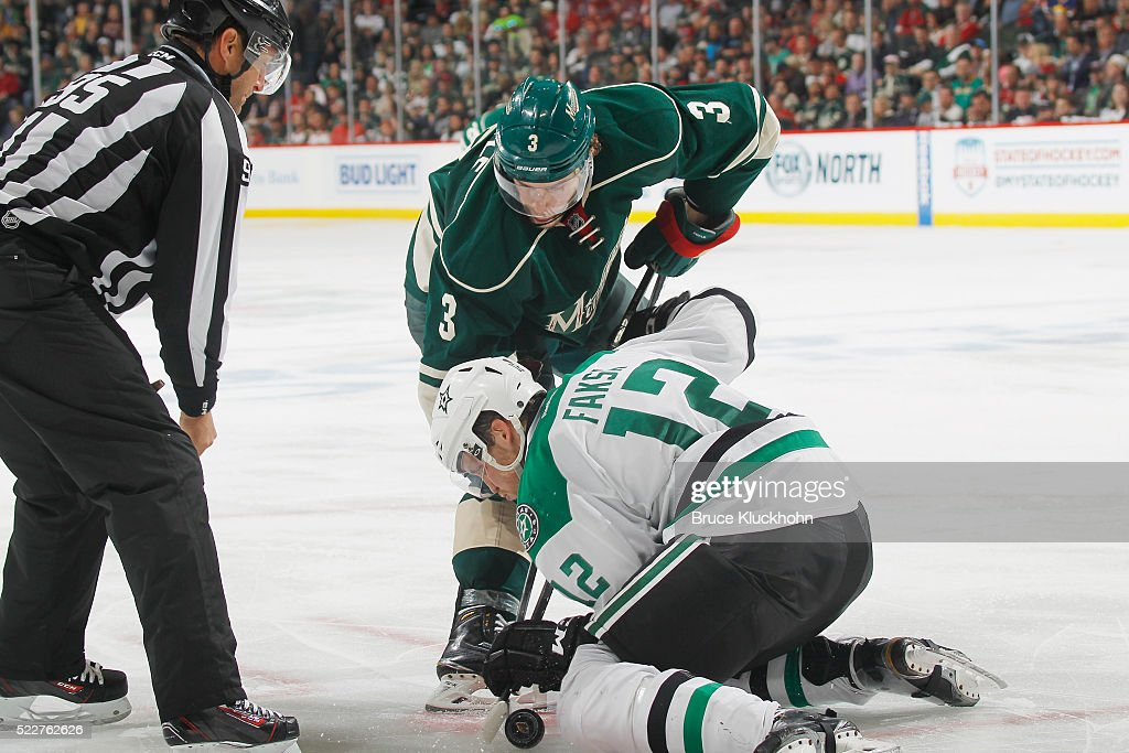 Charlie Coyle #3 of the Minnesota Wild takes a face-off against Radek Faksa #12 of the Dallas Stars in Game Four of the Western Conference First Round during the 2016 NHL Stanley Cup Playoffs on April 20, 2016 at the Xcel Energy Center in St. Paul, Minnesota.