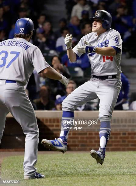 Charlie Culberson and Enrique Hernandez of the Los Angeles Dodgers celebrate after Hernandez hit a home run in the ninth inning against the Chicago...