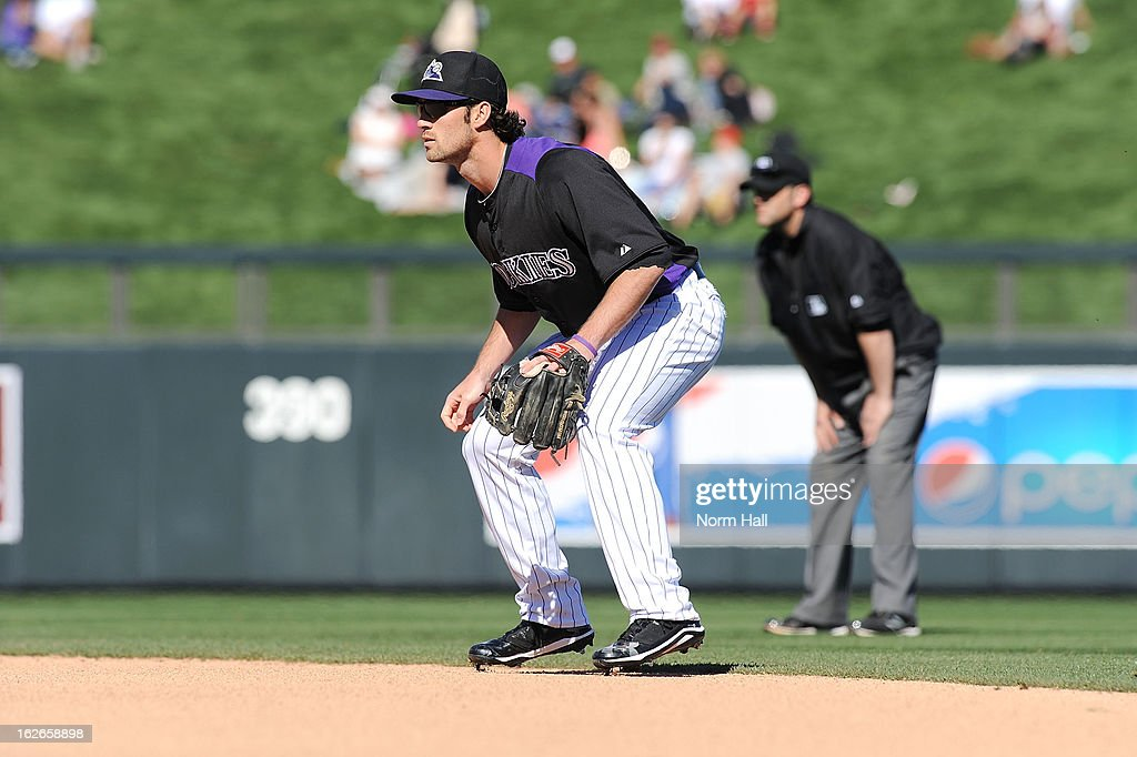 Charlie Culberson #23 of the Colorado Rockies gets ready to make a play against the Texas Rangers at Salt River Field on February 25, 2013 in Scottsdale, Arizona.