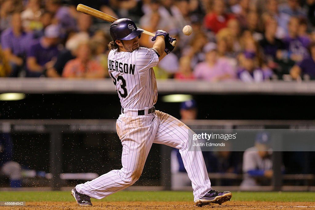 Charlie Culberson #23 of the Colorado Rockies hits a swinging bunt single that scores two runs during the sixth inning against the Los Angeles Dodgers at Coors Field on September 16, 2014 in Denver, Colorado.
