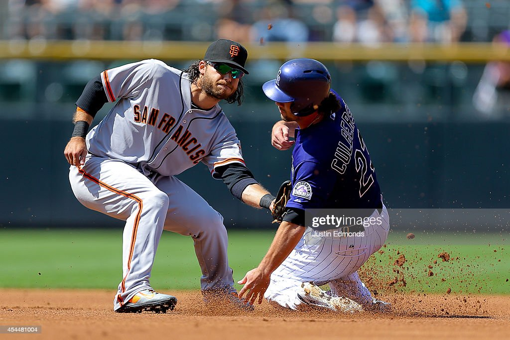 Charlie Culberson #23 of the Colorado Rockies steals second base ahead of the tag of <a gi-track='captionPersonalityLinkClicked' href=/galleries/search?phrase=Brandon+Crawford&family=editorial&specificpeople=5580312 ng-click='$event.stopPropagation()'>Brandon Crawford</a> #35 of the San Francisco Giants during the sixth inning at Coors Field on September 1, 2014 in Denver, Colorado. The teams were resuming a game previously suspended in the sixth inning on May 22 due to rain.