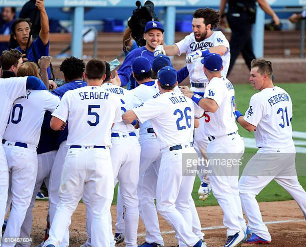 Charlie Culberson of the Los Angeles Dodgers celebrates his solo homerun for a 43 win over the Colorado Rockies during the tenth inning at Dodger...