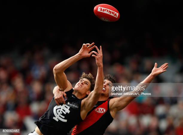 Charlie Curnow of the Blues and Mark Baguley of the Bombers compete for the ball during the 2017 AFL round 20 match between the Essendon Bombers and...