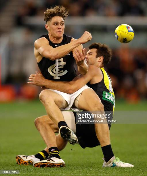 Charlie Curnow of the Blues is tackled by Alex Rance of the Tigers during the 2017 AFL round 14 match between the Richmond Tigers and the Carlton...