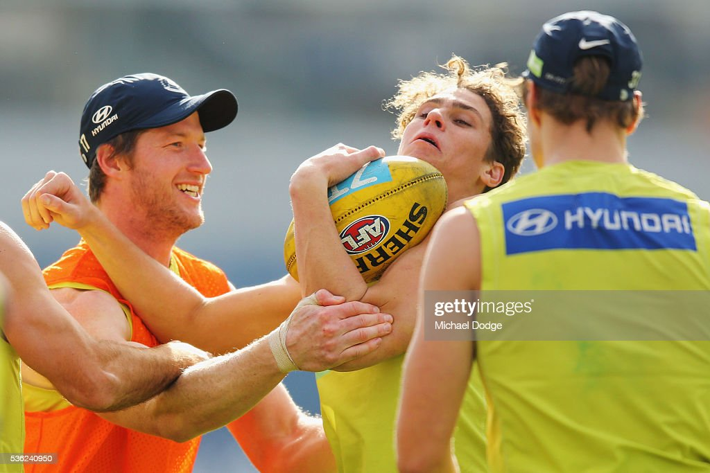 Charlie Curnow of the Blues is tackled by high by Sam Rowe during the Carlton Blues AFL training session at Ikon Park on June 1, 2016 in Melbourne, Australia.