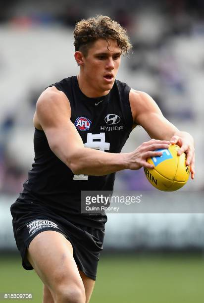 Charlie Curnow of the Blues kicks during the round 17 AFL match between the Carlton Blues and the Western Bulldogs at Melbourne Cricket Ground on...