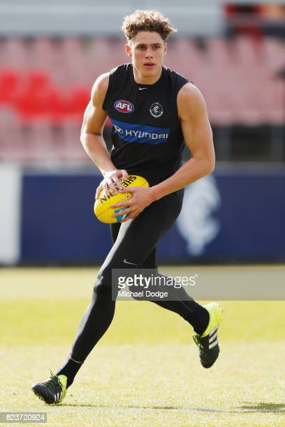 Charlie Curnow of the Blues kicks the ball during a Carlton Blues AFL training session at Visy Park on July 28 2017 in Melbourne Australia