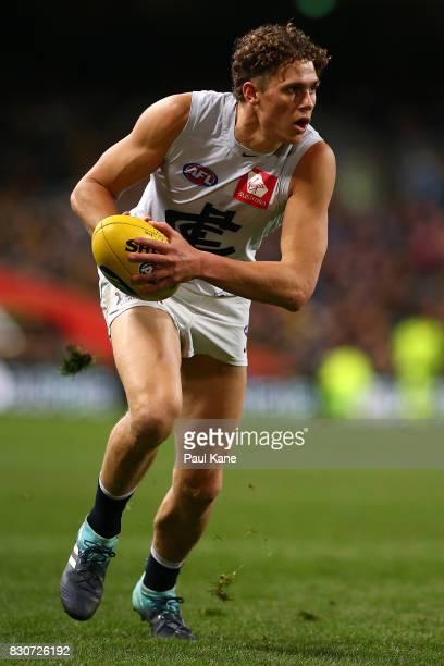 Charlie Curnow of the Blues looks to pass th eball during the round 21 AFL match between the West Coast Eagles and the Carlton Blues at Domain...