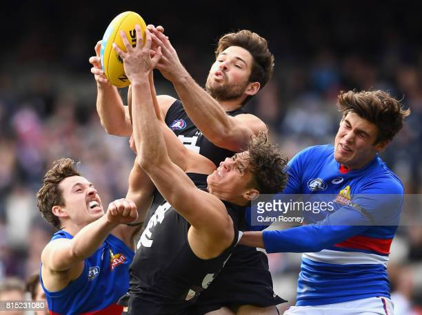 Charlie Curnow of the Blues marks during the round 17 AFL match between the Carlton Blues and the Western Bulldogs at Melbourne Cricket Ground on...