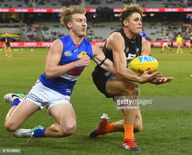Charlie Curnow of the Blues marks infront of Shane Biggs of the Bulldogs during the round 17 AFL match between the Carlton Blues and the Western...