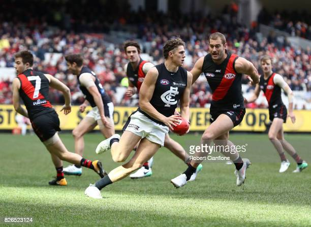 Charlie Curnow of the Blues runs with the ball during the round 20 AFL match between the Essendon Bombers and the Carlton Blues at Melbourne Cricket...