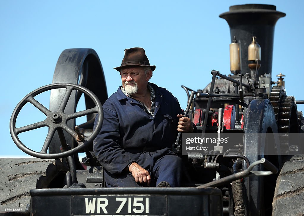 Charlie Daniel sits on his 1918 Fowler steam engine that he is preparing to show at the Cornish Steam and Country Fair at the Stithians Showground on August 16, 2013 near Penryn, England. The annual show, now in 58th year, is one of Cornwall's largest outdoor events and one of the UK's most popular and respected steam rallies.