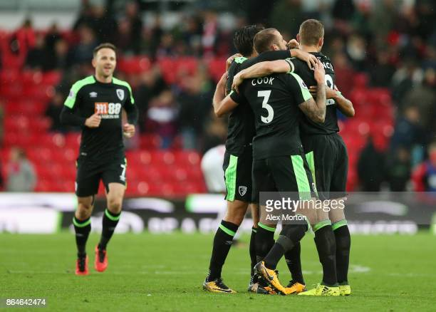 Charlie Daniels Nathan Ake Steve Cook and Simon Francis of AFC Bournemouth celebrate after the Premier League match between Stoke City and AFC...
