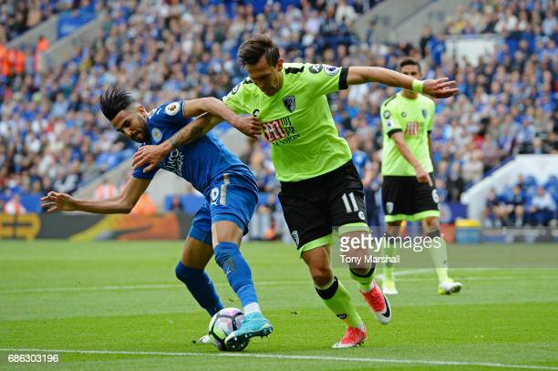 Charlie Daniels of AFC Bournemouth and Riyad Mahrez of Leicester City in action during the Premier League match between Leicester City and AFC...