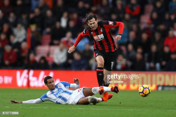 Charlie Daniels of AFC Bournemouth is tackled by Tom Ince of Huddersfield Town during the Premier League match between AFC Bournemouth and...