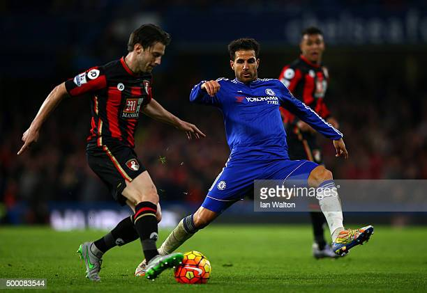 Charlie Daniels of Bournemouth and Cesc Fabregas of Chelsea compete for the ball during the Barclays Premier League match between Chelsea and AFC...