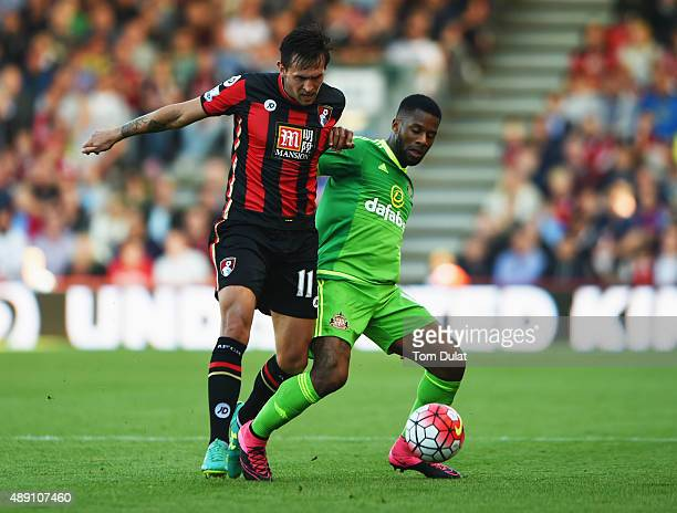 Charlie Daniels of Bournemouth and Jeremain Lens of Sunderland compete for the ball during the Barclays Premier League match between AFC Bournemouth...
