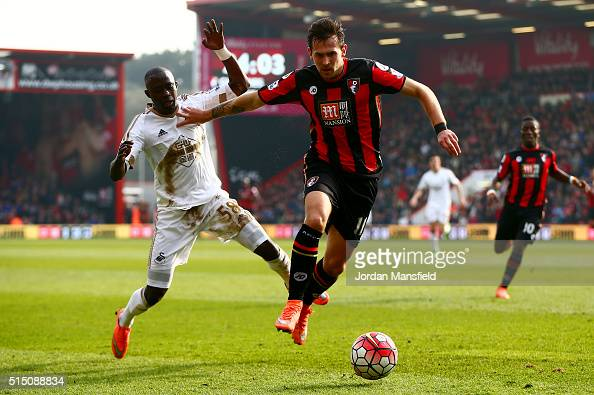 Charlie Daniels of Bournemouth and Modou Barrow of Swansea City compete for the ball during the Barclays Premier League match between AFC Bournemouth...