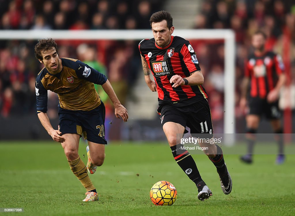 Charlie Daniels of Bournemouth is chased by Mathieu Flamini of Arsenal during the Barclays Premier League match between AFC Bournemouth and Arsenal...