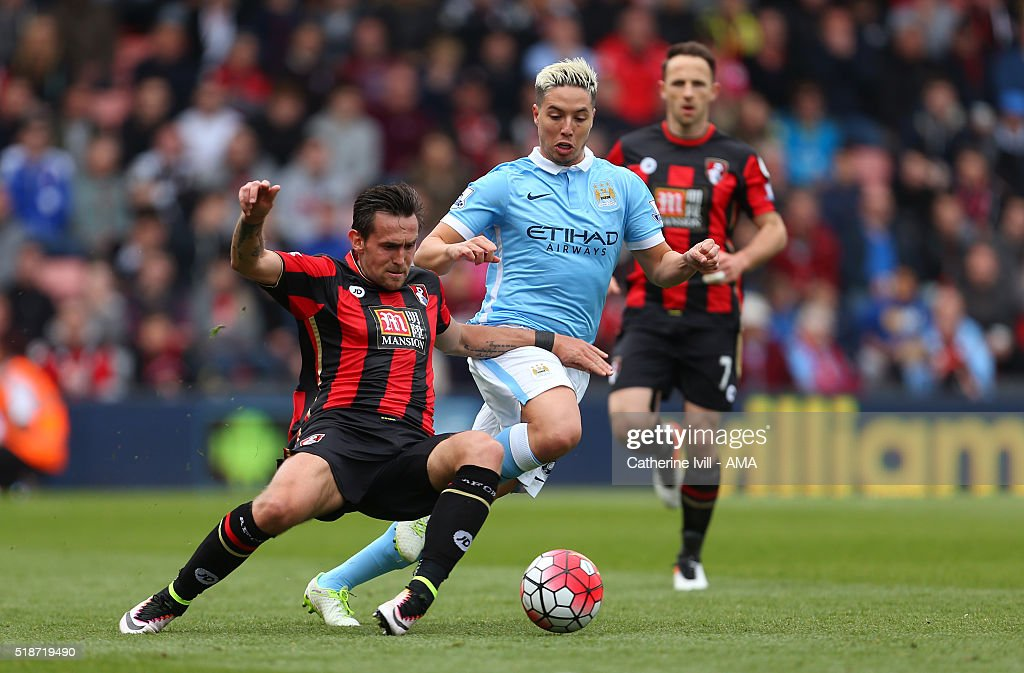 Charlie Daniels of Bournemouth tackles Samir Nasri of Manchester City during the Barclays Premier League match between AFC Bournemouth and Manchester...