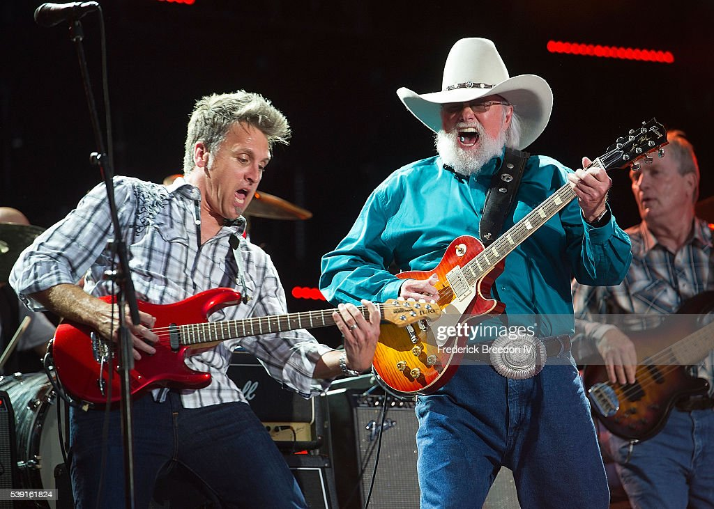 Charlie Daniels performs with his lead guitarist Christopher Wormer at Nissan Stadium on June 9 2016 in Nashville Tennessee