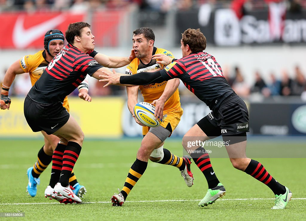 Charlie Davies of London Wasps is tackled during the Aviva Premiership match between Saracens and London Wasps at Allianz Park on October 5, 2013 in Barnet, England.