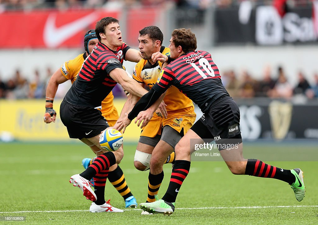 <a gi-track='captionPersonalityLinkClicked' href=/galleries/search?phrase=Charlie+Davies&family=editorial&specificpeople=2297598 ng-click='$event.stopPropagation()'>Charlie Davies</a> of London Wasps is tackled during the Aviva Premiership match between Saracens and London Wasps at Allianz Park on October 5, 2013 in Barnet, England.