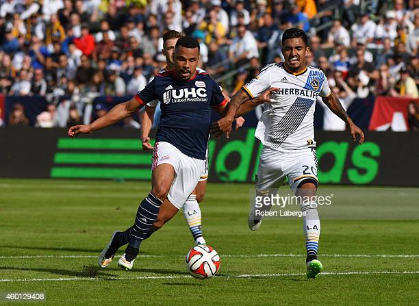 Charlie Davies of the New England Revolution handles the ball against A J DeLaGarza the Los Angeles Galaxy during the 2014 MLS Cup match at the at...