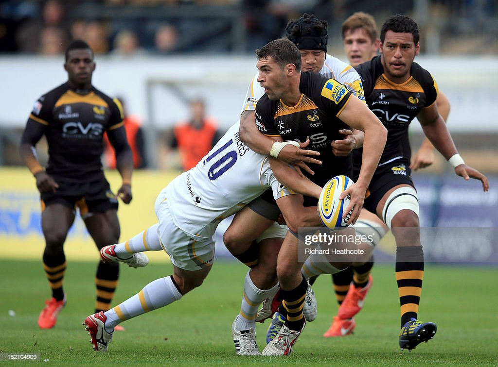 Charlie Davies of Wasps is tackled by Ignacio Mieres of Worcester during the Aviva Premiership match between London Wasps and Worcester Warriors at Adams Park on September 28, 2013 in High Wycombe, England.