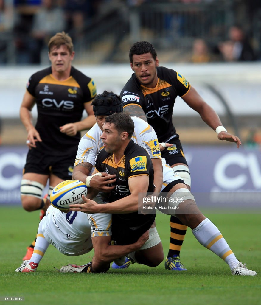 <a gi-track='captionPersonalityLinkClicked' href=/galleries/search?phrase=Charlie+Davies&family=editorial&specificpeople=2297598 ng-click='$event.stopPropagation()'>Charlie Davies</a> of Wasps is tackled by <a gi-track='captionPersonalityLinkClicked' href=/galleries/search?phrase=Ignacio+Mieres&family=editorial&specificpeople=696015 ng-click='$event.stopPropagation()'>Ignacio Mieres</a> of Worcester during the Aviva Premiership match between London Wasps and Worcester Warriors at Adams Park on September 28, 2013 in High Wycombe, England.