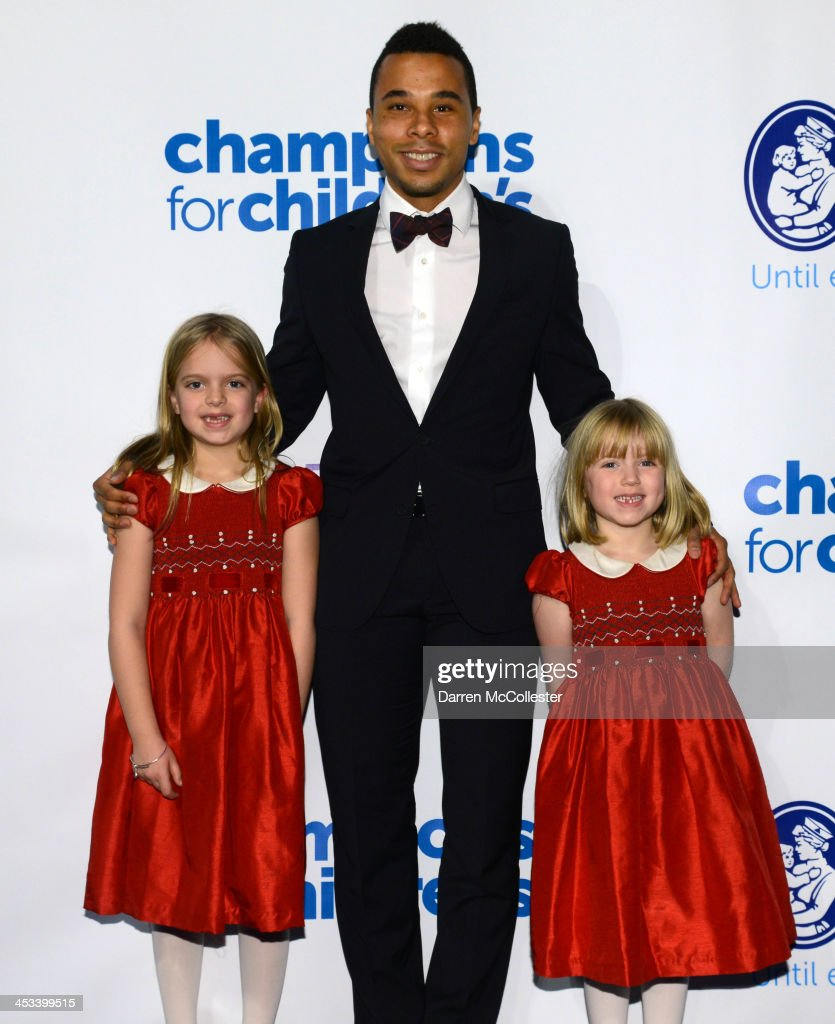 Charlie Davis of the New England Revolution attends Champions for Children's with Avery (L) and Annika at Seaport World Trade Center on December 3, 2013 in Boston, Massachusetts.