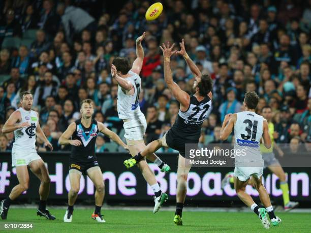 Charlie Dickson of the Power marks the ball against Sam Rowe during the round five AFL match between the Port Adelaide Power and thew Carlton Blues...