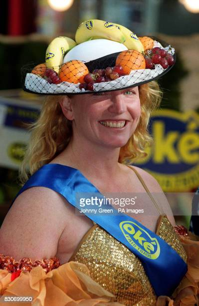 Charlie Dimmock with a selection of fairtrade fruit designed headwear in Soho central London The pair are supporting AgroFair UK which is the...