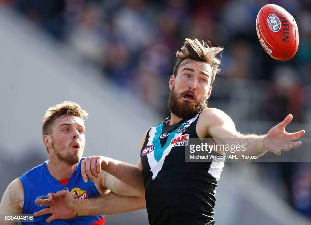 Charlie Dixon of the Power and Jordan Roughead of the Bulldogs compete in a ruck contest during the 2017 AFL round 22 match between the Western...