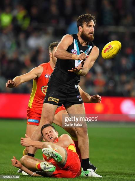 Charlie Dixon of the Power handballs during the round 23 AFL match between the Port Adelaide Power and the Gold Coast Suns at Adelaide Oval on August...