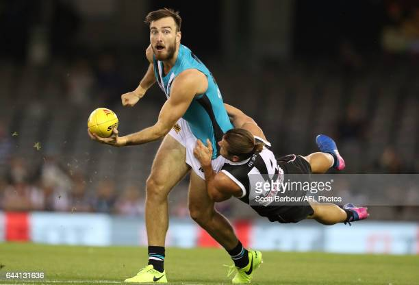 Charlie Dixon of the Power is tackled by Maverick Weller of the Saints during the AFL 2017 JLT Community Series match between the St Kilda Saints and...