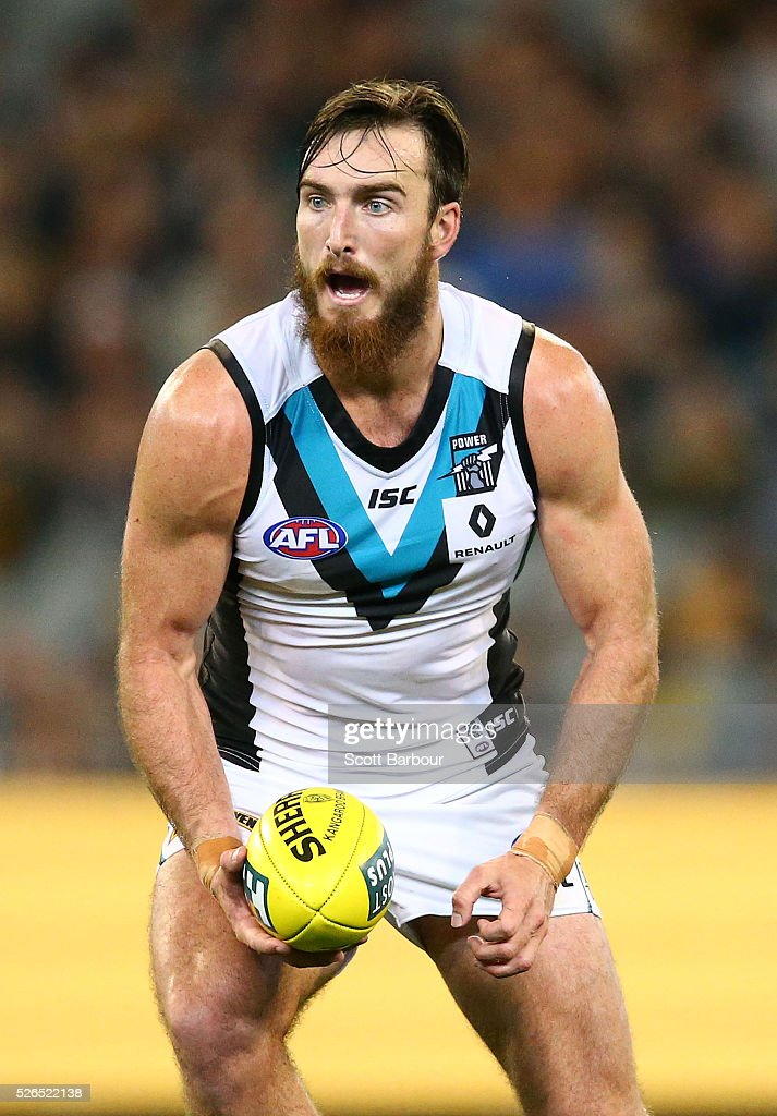 Charlie Dixon of the Power runs with the ball during the round six AFL match between the Richmond Tigers and the Port Adelaide Power at Melbourne Cricket Ground on April 30, 2016 in Melbourne, Australia.