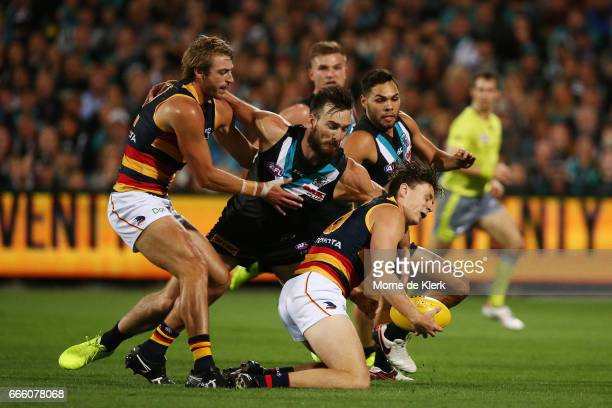 Charlie Dixon of the Power tackles Jake Lever of the Crows during the round three AFL match between the Port Adelaide Power and the Adelaide Crows at...