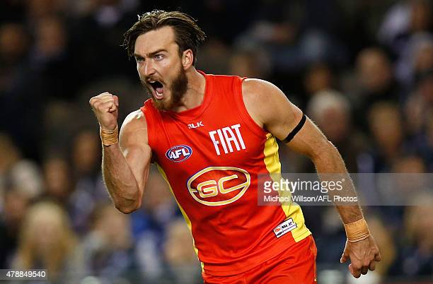 Charlie Dixon of the Suns celebrates a goal during the 2015 AFL round thirteen match between the Carlton Blues and the Gold Coast Suns at Etihad...