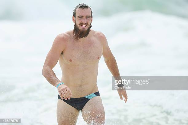 Charlie Dixon of the Suns swims at Kurrawa Beach during a media session on March 3 2014 in Gold Coast Australia