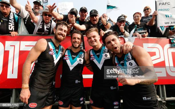 Charlie Dixon Travis Boak Ollie Wines and Chad Wingard of the Power celebrate during the 2017 AFL round 08 match between the Gold Coast Suns and Port...