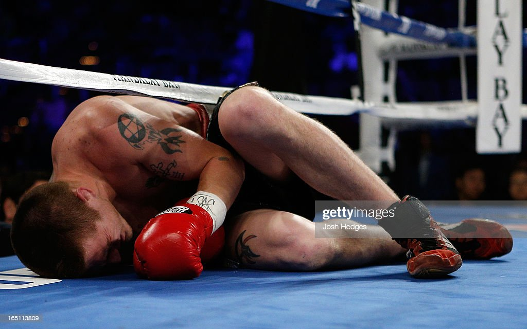 Charlie Dubray lies on the canvas in pain after being knocked down by a body shot from Jose Carlos Ramirez in their lightweight bout at the Mandalay Bay Events Center on March 30, 2013 in Las Vegas, Nevada.