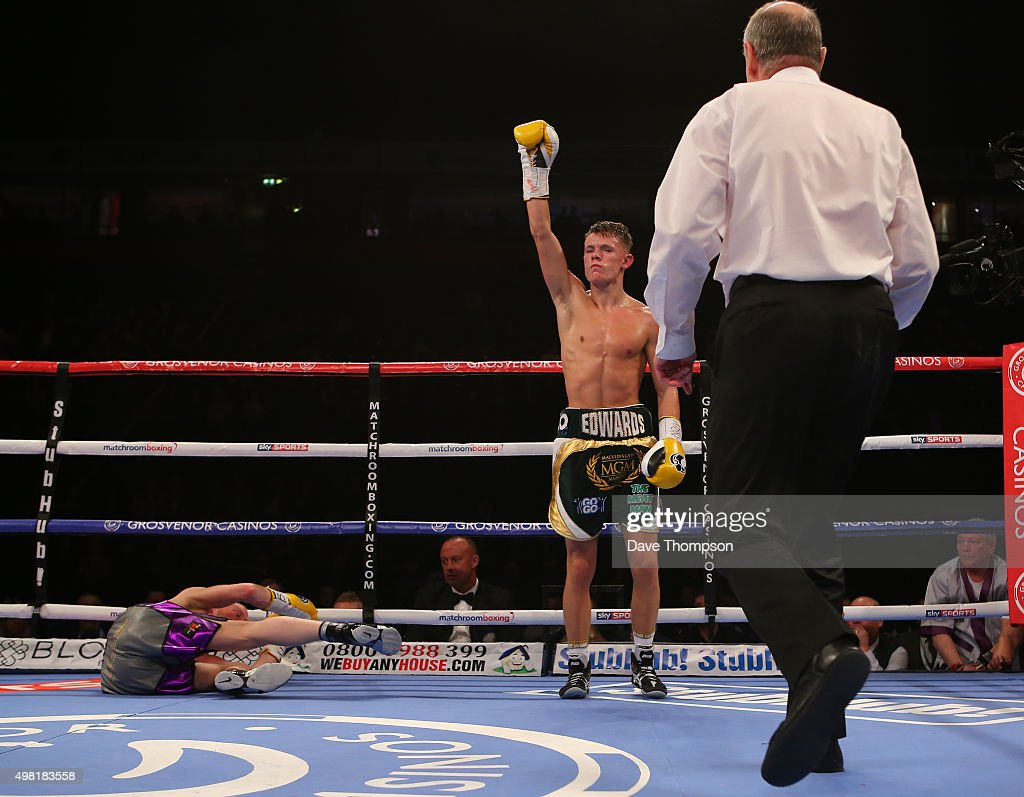 Charlie Edwards stands over Phil Smith during their English Flyweight Championship bout at the Manchester Arena on November 21 2015 in Manchester...